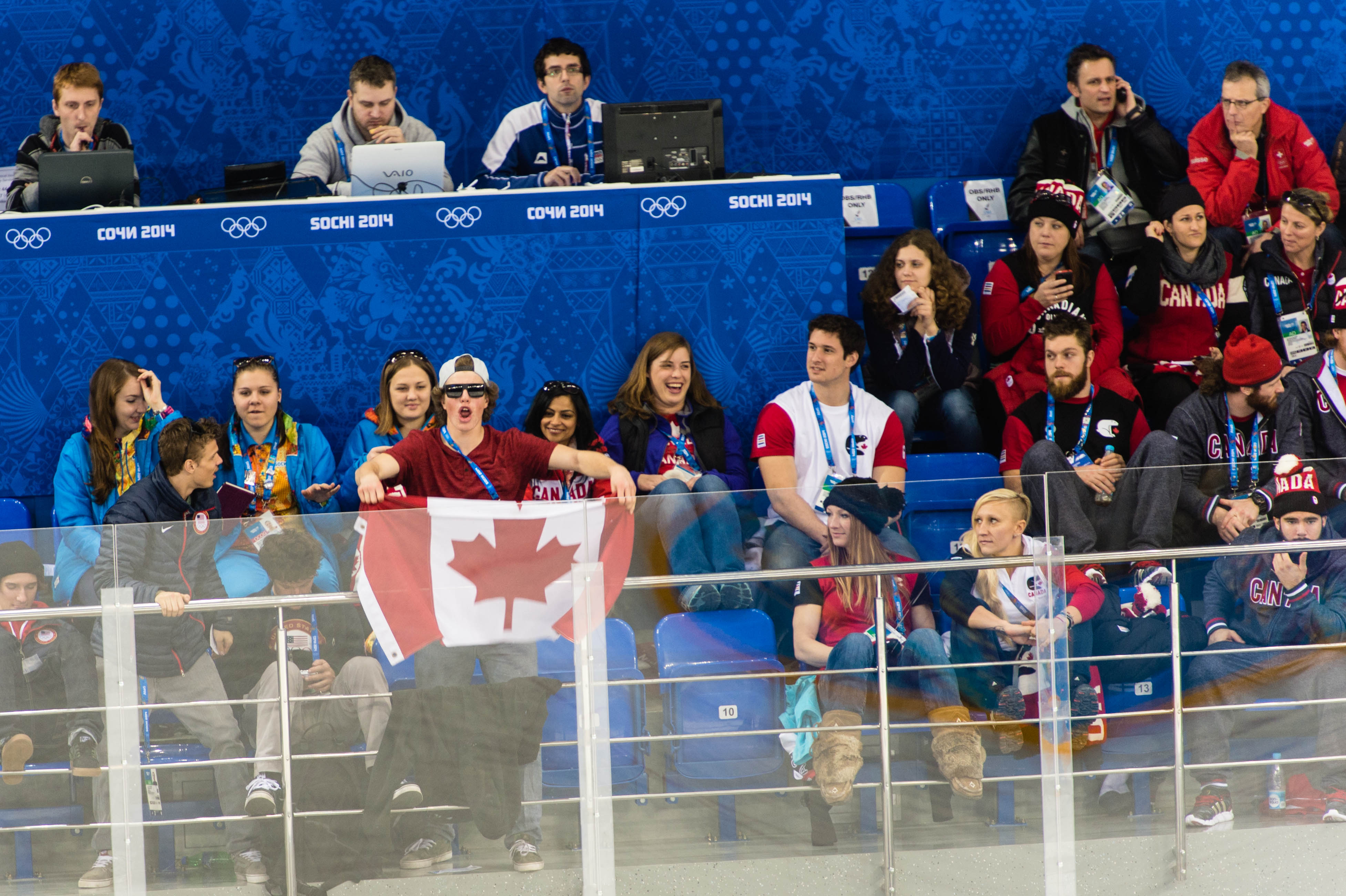 Fellow Canadian athletes cheer on the Women's Hockey Team.