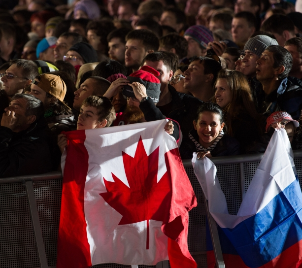 Fans holding up the Canadian flag