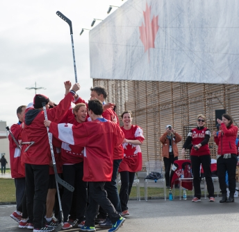 Team Canada cheers in the huddle