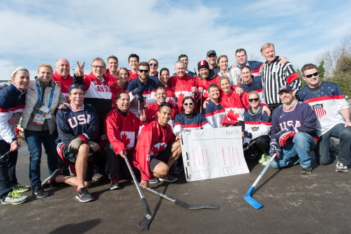 Canada vs. USA Ball Hockey teams pose for a picture