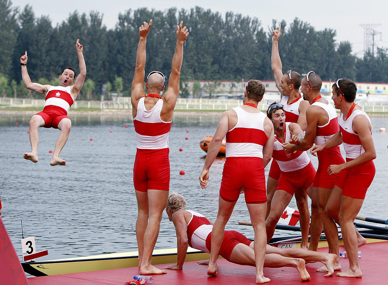 Canadian Men's Eight coxswain Brian Price gets tossed off the dock by his gold medalist team Canadian Men's Eight team at the Shunyi Olympic Rowing-Canoeing Park during the 2008 Beijing Olympic Games in Beijing Aug 17, 2008.  The Canadian Men's eight got the gold while Great Britain took silver and USA bronze. THE CANADIAN PRESS / COC ANDRE FORGET