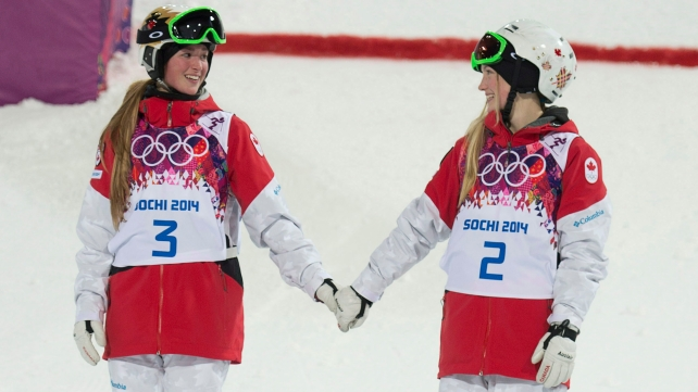Canada's Justine Dufour-Lapointe and Chloe Dufour-Lapointe holds hands before climbing