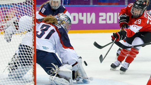 Marie-Philip Poulin of Canada (29) shoots to score the tying goal against USA goalkeeper Jessie Vetter (31) during the third period of the women's gold medal ice hockey game at the 2014 Winter Olympics, Thursday, Feb. 20, 2014, in Sochi, Russia. (AP Photo/Matt Slocum)