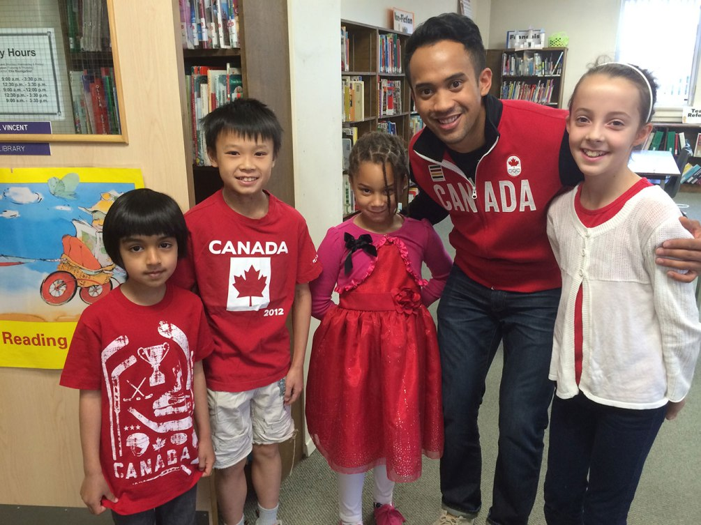 Junio meets with the medal presenters at King Edward PS. The students raised $161 toward the #ThanksGilmore campaign.