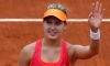 Bouchard fights back to earn French Open semifinal spot