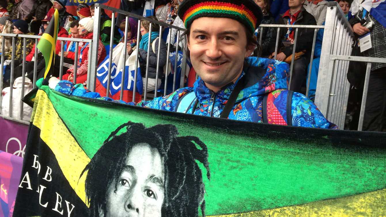 A Russian fan at track side in the Sanki Sliding Centre in Sochi supporting Jamaica.
