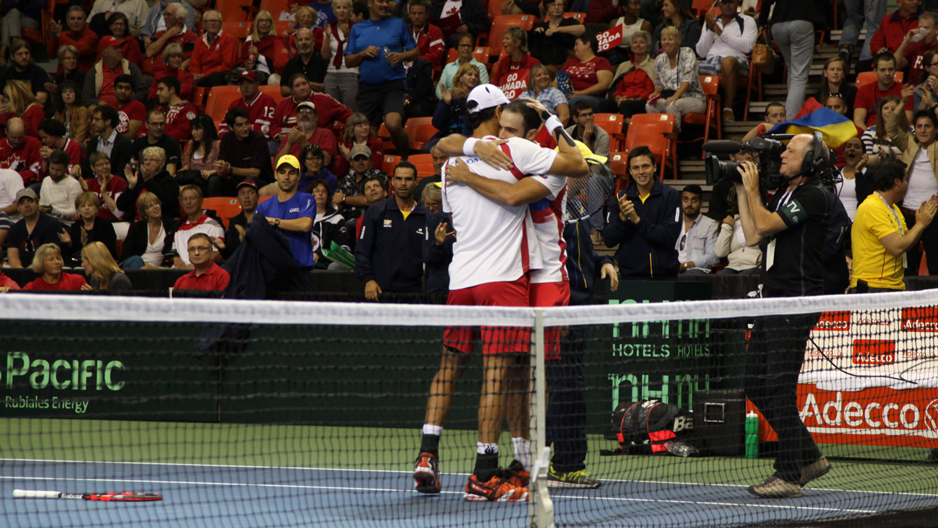 Juan Sebastian Cabal and Robert Farah embrace after keeping Colombia alive in their Davis Cup tie versus Canada.