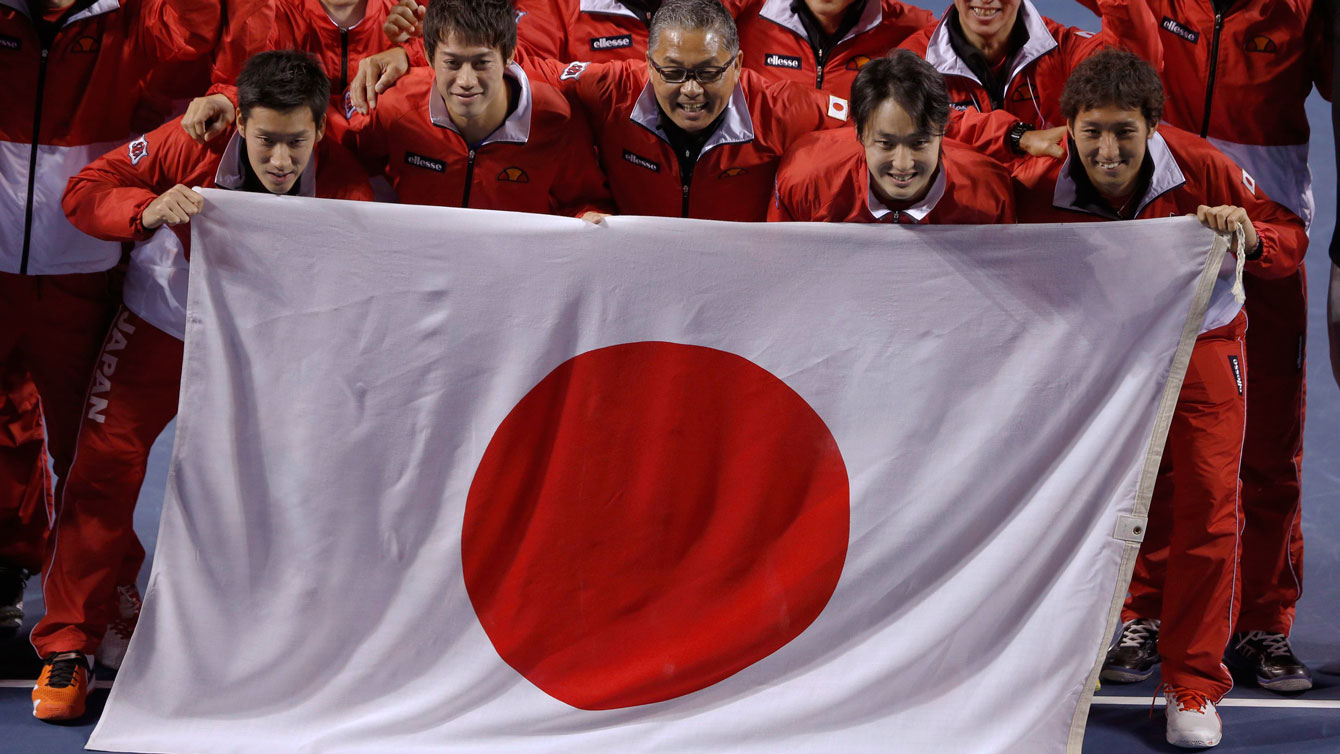 Japanese team poses with their flag following their defeat of Canada in the 2014 Davis Cup.
