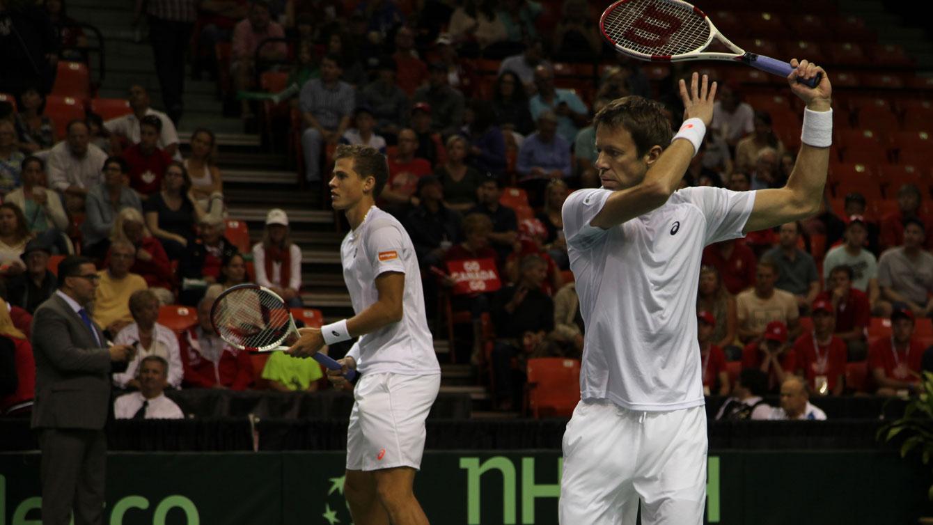 Daniel Nestor (right) and Vasek Pospisil during warm-up prior to their Davis Cup match versus Colombia's Juan Sebastian Cabal and Robert Farah.