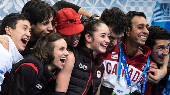 Canada's figure skating team congratulates Kaetlyn Osmond after a performance in the team event at Sochi 2014.