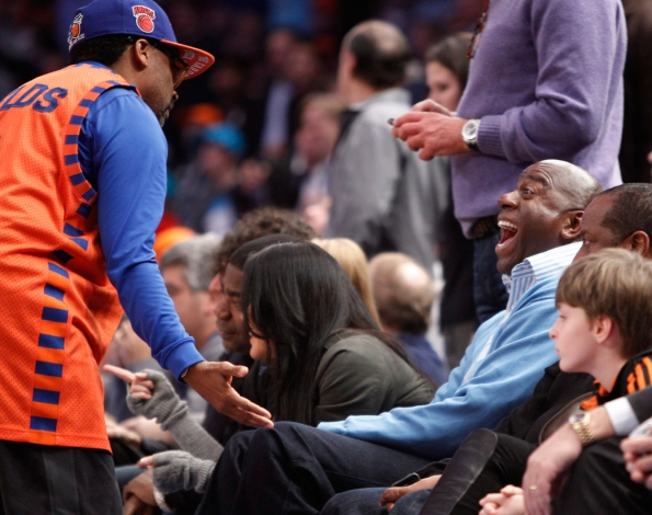 Spike enjoys a laugh with Magic Johnson. Photo: CP