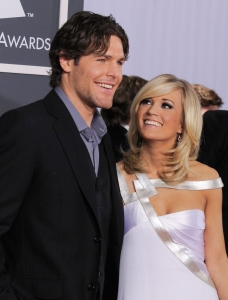 Predator Mike Fisher accompanies Underwood to the Grammys in 2010. Photo: CP
