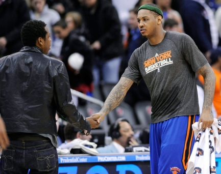 New York Knick Carmelo Anthony shakes hands with Jay-Z. Photo: CP