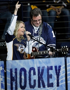 Underwood and Vince Gill performing during an intermission at a Predators playoff game in 2011. Photo: CP