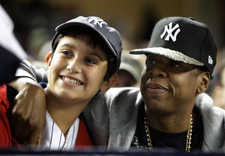 Jay-Z poses with a fan. Photo: CP