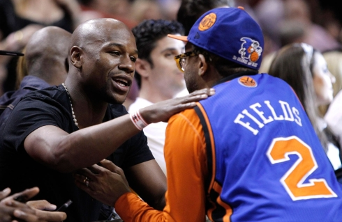 Boxer Floyd Mayweather Jr is greeted by Spike. Photo: CP