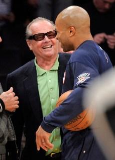 Nicholson jokes around with former Laker Derek Fisher. Photo: CP