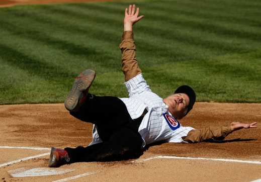 Bill Murray sliding into home at Wrigley before he throws out the first pitch.