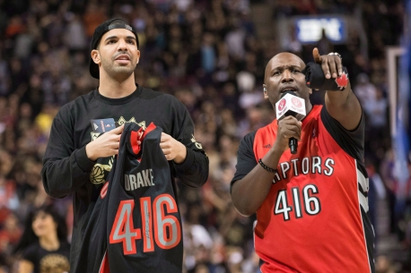 Drake chatting with the Raps announcer. Photo: CP