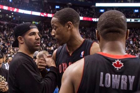 Drake gives Raptors guard Demar Derozan props after a game. Photo: CP