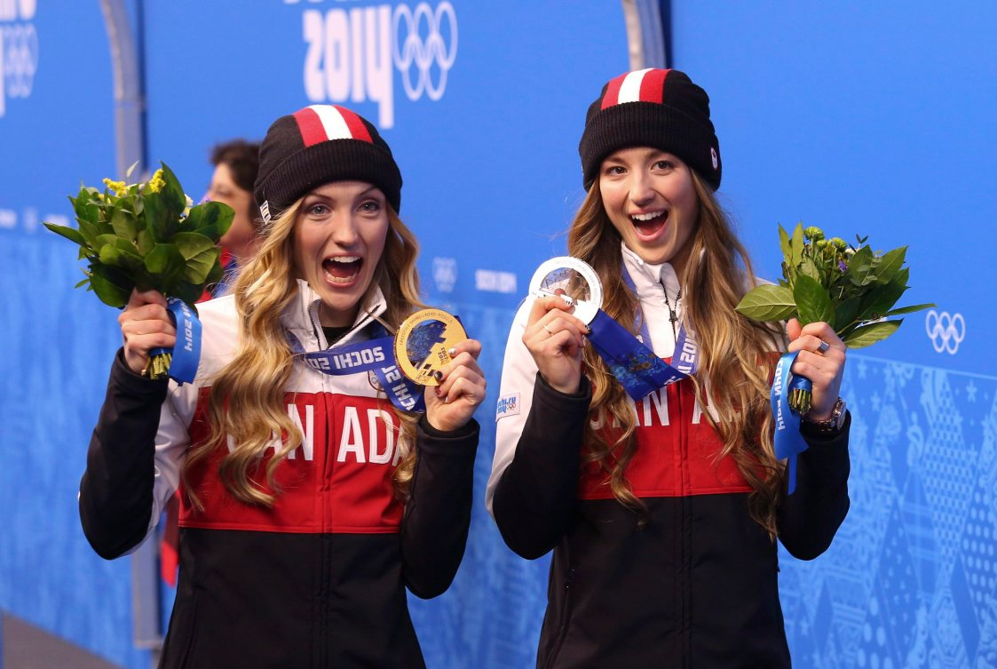 Justine Dufour-Lapointe (left) holds her gold medal and sister Chloe holds here silver for women's moguls after the medal ceremony at the Sochi Winter Olympics in Sochi, Russia, Sunday, Feb. 9, 2014. THE CANADIAN PRESS/HO, COC - Mike Ridewood