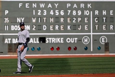 The left field scoreboard pays tribute to Derek Jeter. Photo: CP