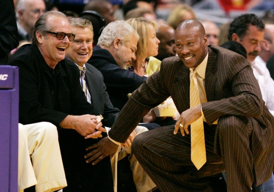 New Orleans Hornets coach, and former LA Laker, Byron Scott jokes with Nicholson during a game. Photo: CP