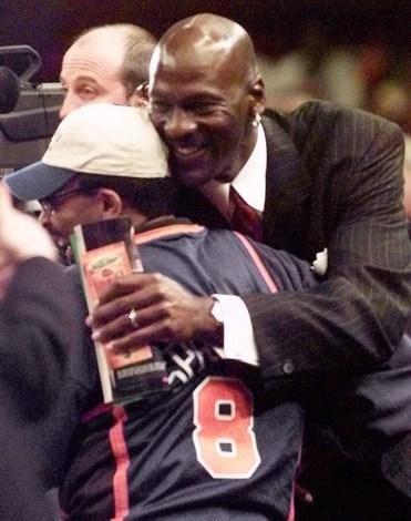 Spike Lee gets a hug from Michael Jordan. Photo: CP