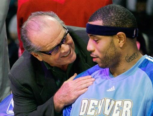 Nicholson gives some tips to Denver Nugget Kenyon Martin. Photo: CP