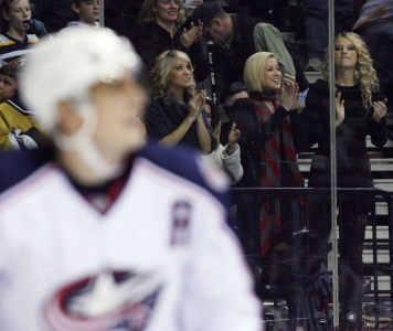 Country singers Underwood, left, Kellie Pickler, centre, and Taylor Swift cheering on the Predators. Photo: CP