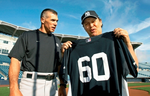 Billy Crystal with manager Joe Girardi. Photo: CP