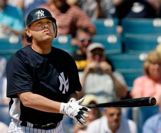 Billy Crystal taking an at-bat as a New York Yankee. Photo: CP