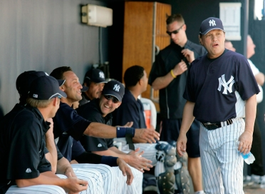Derek Jeter looking for some love from Billy Crystal. Photo: CP