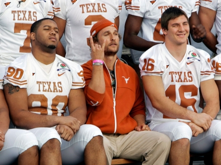 McConaughey sits with players during a team photo. Photo: CP