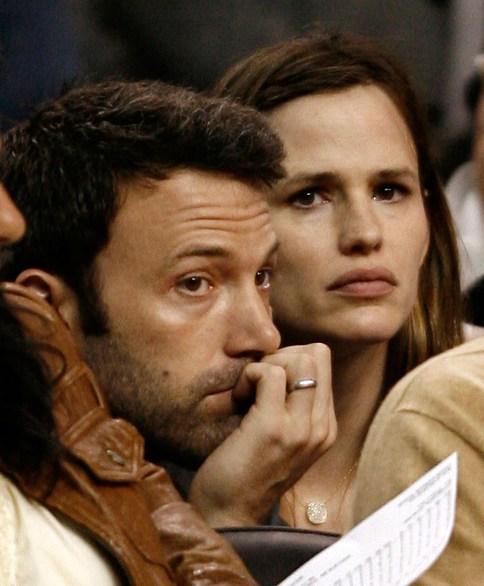 Ben Affleck and Jennifer Garner finding it hard to be fans at a Celtics game. Photo: CP