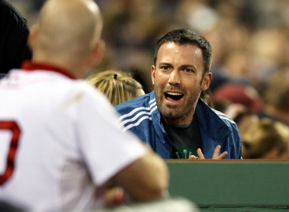 Ben Affleck talking with players in the dugout during a Red Sox game. Photo: CP