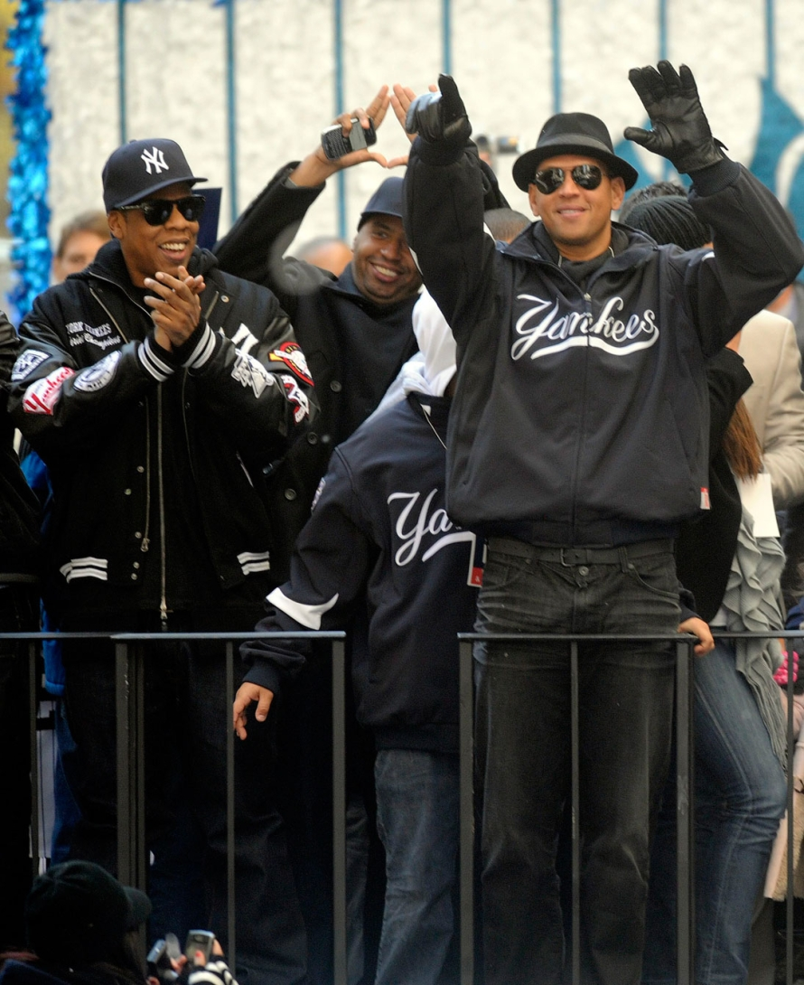 Jay-Z and Alex Rodriguez celebrate the Yankees 2009 World Series win during the parade. Photo: CP