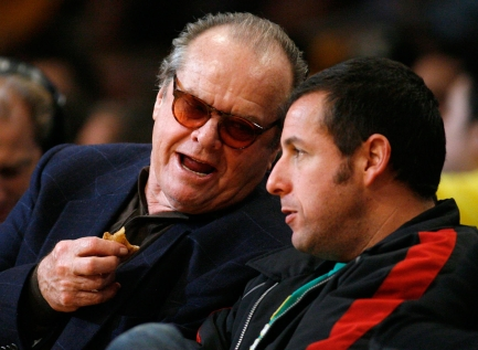 Jack Nicholson and Adam Sandler discuss life during a Lakers game. Photo: CP
