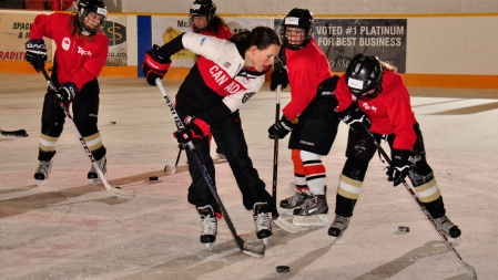 Catherine Ward demonstrates stick-handling techniques on ice.