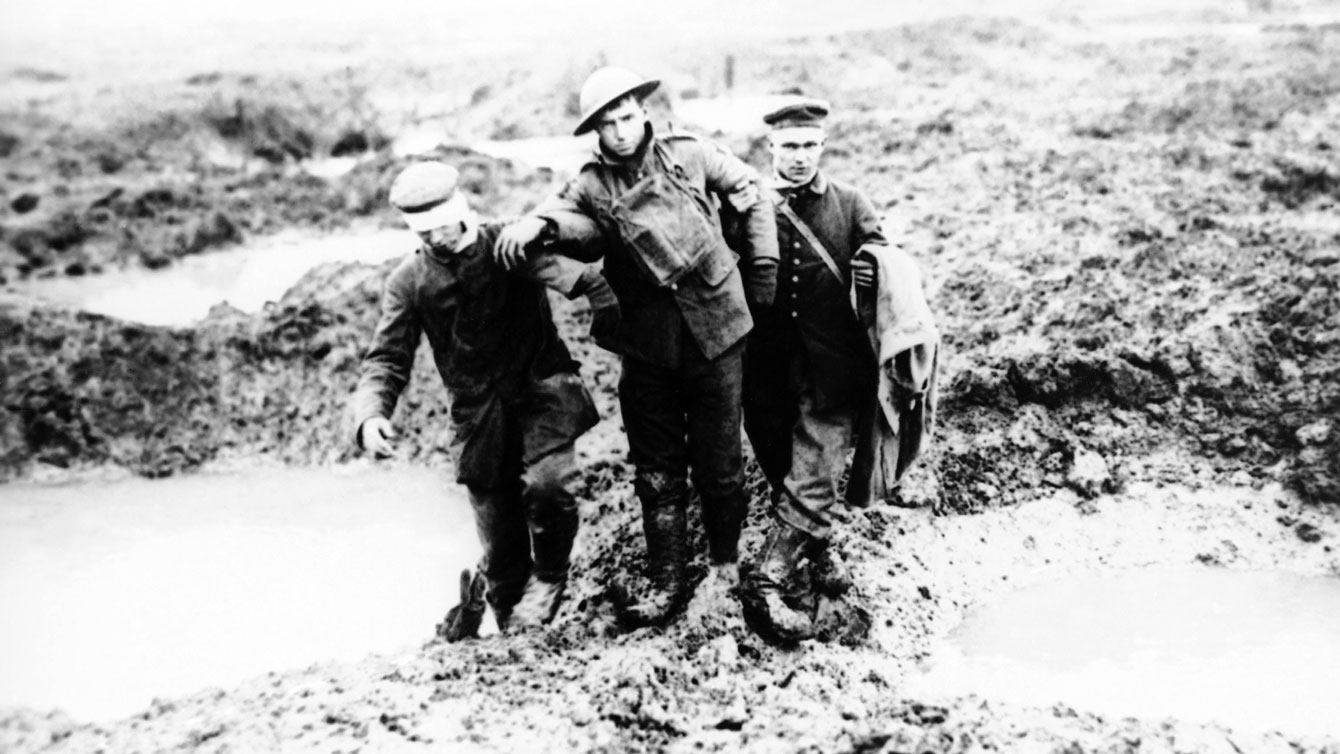 From Canadian Press: 1917 file photo, wounded Canadian and German World War One soldiers help one another through the mud during the Battle of Passchendaele in Passchendaele, Belgium.