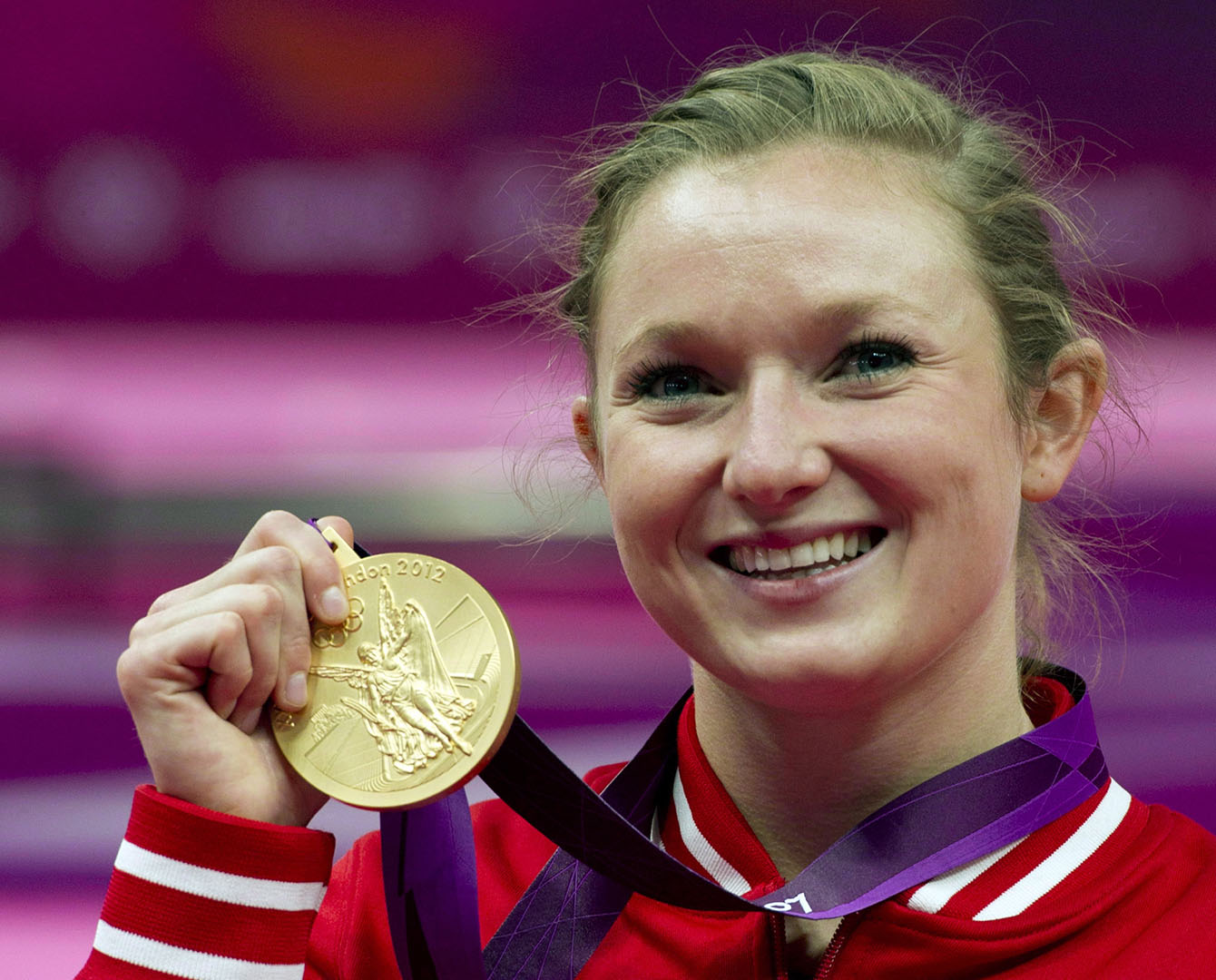 Canada's Rosannagh MacLennan, from King City, Ont., holds up her gold medal for the women's trampoline at the 2012 Olympic Games in London on August 4, 2012. Over the next few days, Canada's Olympic medallists will likely return home to a hero's welcome. But once the dust settles, it's unlikely they'll be cashing in on their Summer Games success. THE CANADIAN PRESS/Ryan Remiorz