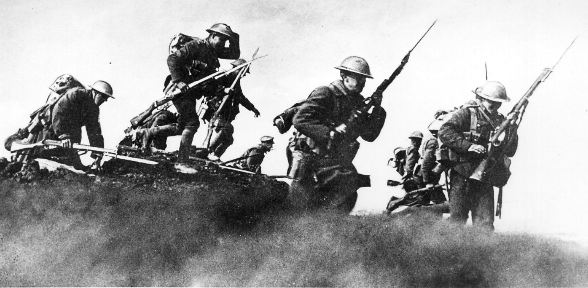 From Canadian Press: soldiers climb out of the trenches in the First World War.