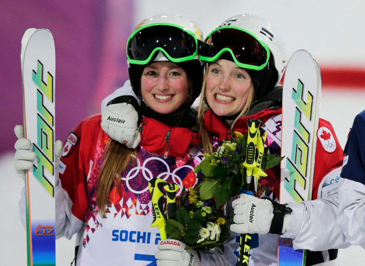 Justine and Chloé Dufour-Lapointe celebrate after winning gold and silver medals