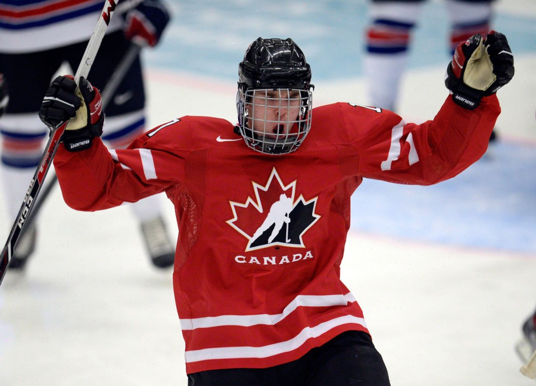 16 year-old Connor McDavid celebrates a goal during the 2014 World Junior Championship (Photo: CP)