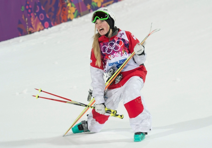 Justine Dufour-Lapointe celebrates her gold medal in women's moguls
