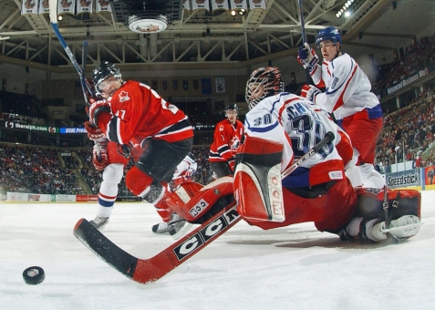 Nigel Dawes puts a puck past the Czech goalie during their semifinal (Photo: CP)