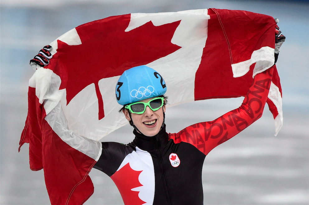Canada's Charle Cournoyer celebrates after winning the bronze medal in the men's 500 metre final at the Sochi Winter Olympics Friday, February 21, 2014 in Sochi. THE CANADIAN PRESS/Paul Chiasson