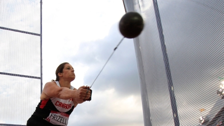 Sultana Frizell with one of her record setting throws at Glasgow 2014 Commonwealth Games.
