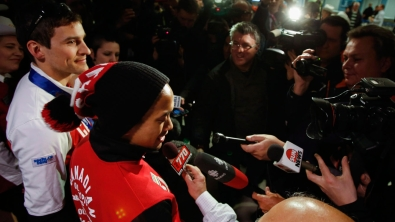 Morrison (left) and Junio meet an awaiting Canadian media at the airport upon their return from Sochi.