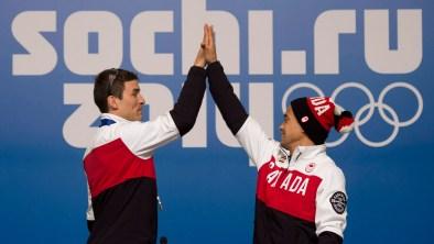 Denny Morrison (left) and Gilmore Junio high-five at Sochi's Main Press Centre.